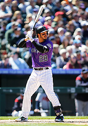 April 8, 2018 - Denver, CO, U.S. - DENVER, CO - APRIL 08: Colorado Rockies infielder Nolan Arenado (28) bats during a regular season MLB game between the Colorado Rockies and the visiting Atlanta Braves on April 8, 2018 at Coors Field in Denver, CO. (Photo by Russell Lansford/Icon Sportswire) (Credit Image: © Russell Lansford/Icon SMI via ZUMA Press)