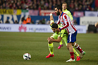 Atletico de Madrid´s Arda Turan and Barcelona´s Luis Suarez during 2014-15 Spanish King Cup match between Atletico de Madrid and Barcelona at Vicente Calderon stadium in Madrid, Spain. January 28, 2015. (ALTERPHOTOS/Luis Fernandez)