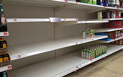 © Licensed to London News Pictures. 20/09/2021. London, UK. Nearly empty shelves of cartons fruit juice in Sainsbury's in north London as fears of food shortages grow after two of the UK's biggest Carbon Dioxide (CO2) producers halted production last week due to soaring gas prices. Photo credit: Dinendra Haria/LNP