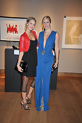 Left to right, DONNA AIR and TANIA BRYER at fundraising dinner and auction in aid of Liver Good Life a charity for people with Hepatitis held at Christies, King Street, London on 16th September 2009.