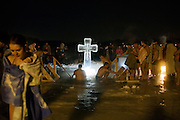 Moscow, Russia, 19/01/2011..Orthodox Christian believers celebrate Epiphany at a lake in eastern Moscow. Priests blessed the waters and followers baptised themselves by total immersion in the freezing lake in temperatures of minus 15C.
