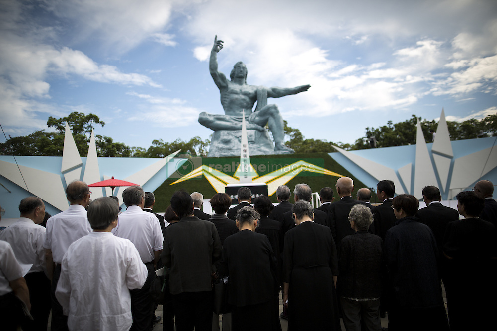 August 9, 2016 - Nagasaki, Nagasaki Prefecture, Japan - NAGASAKI, JAPAN - AUGUST 9 : People pray for the atomic bomb victims in front of the Nagasaki Peace Park in Nagasaki, southern Japan, Tuesday, August 9, 2016. Japan marked the 71st anniversary of the atomic bombing on Nagasaki. On August 9, 1945, during World War II, the United States dropped the second Atomic bomb on Nagasaki city, killing an estimated 40,000 people which ended World War II. (Credit Image: © Richard Atrero De Guzman/NurPhoto via ZUMA Press)
