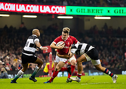 Jarrod Evans of Wales under pressure from Andre Esterhuizen of Barbarians <br /> <br /> Photographer Simon King/Replay Images<br /> <br /> Friendly - Wales v Barbarians - Saturday 30th November 2019 - Principality Stadium - Cardiff<br /> <br /> World Copyright © Replay Images . All rights reserved. info@replayimages.co.uk - http://replayimages.co.uk