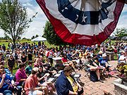 """04 JULY 2019 - INDIANOLA, IOWA: Part of the crowd waiting for Senator Kamala Harris before a campaign event. Sen. Harris attended a """"house party"""" in Indianola as a part of her campaign to be the Democratic nominee for the US presidency in 2020. Iowa traditionally holds the first selection of the presidential election cycle. The Iowa caucuses are Feb. 3, 2020.       PHOTO BY JACK KURTZ"""