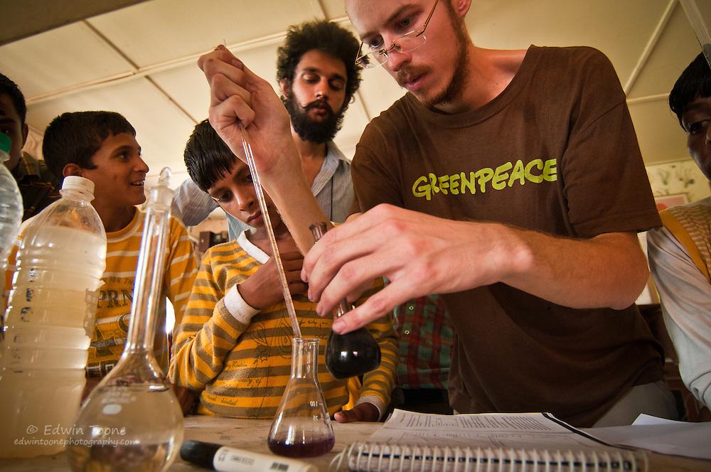 International scientist work with volunteers to teach local children about soil and biodiversity.