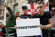 Demonstration calling for the release from jail of former English Defence League, EDL, leader Tommy Robinson on June 9th 2018 in London, England, United Kingdom. Far right groups gathered shouting Free Tommy Robinson, blaming the police for his arrest and calling for free speech. Opposition groups gathered nearby.