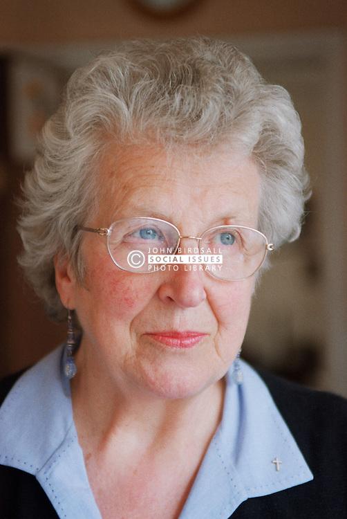 Portrait of elderly woman looking serious,