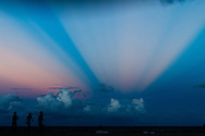 Anti-crepuscular rays of the setting sun are visible over the Atlantic Ocean off Hollywood Beach, Florida. WATERMARKS WILL NOT APPEAR ON PRINTS OR LICENSED IMAGES.