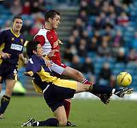 Picture: Henry Browne.<br />Date: 13/12/2003.<br />Wimbledon v Walsall Nationwide First Division.<br />Rob Gier of Dons challenges Gary Birch of Walsall