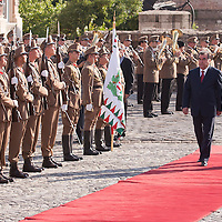 President of Tajikistan Emomali Rahmon (L) and his Hungarian counterpart Pal Schmitt (R) inspect the guard of honor during a welcoming ceremony in Budapest, Hungary on June 10, 2011. ATTILA VOLGYI.Emomali Rahmon is in Hungary fro a two-day official visit.