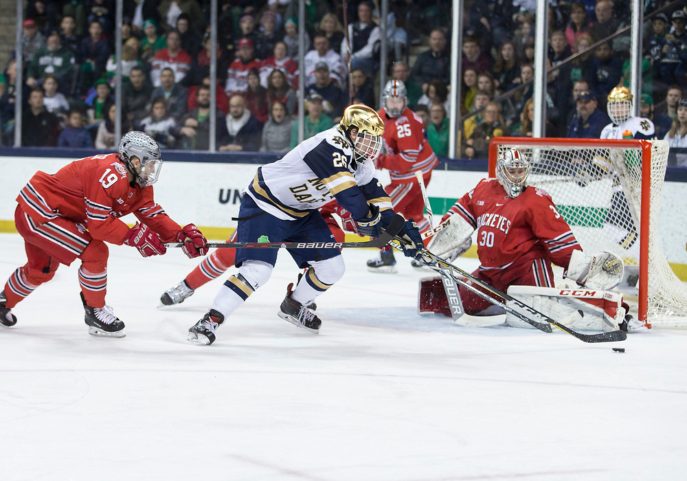 March 17, 2018:  Notre Dame forward Cam Morrison (26) shoots the puck on Ohio State goaltender Sean Romeo (30) during NCAA Hockey game action between the Notre Dame Fighting Irish and the Ohio State Buckeyes at Compton Family Ice Arena in South Bend, Indiana.  Notre Dame defeated Ohio State 3-2 in overtime.  John Mersits/CSM