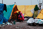 India, New Delhi, Majnu Ka Tila tibetan refugee camp. women outside their tents