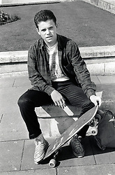 Teenage boy with skateboard, UK 1989