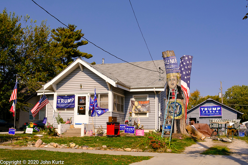 08 OCTOBER 2020 - DES MOINES, IOWA: A home on the east side of Des Moines decorated with President Donald Trump campaign materials, included a tree trunk with Trump's likeness painted on it.    PHOTO BY JACK KURTZ