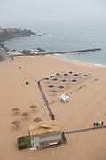 Sun parasols and deckchairs at Fisherman's Beach on 25th May 2018 in Ericeira in Portugal. Ericeira is a civil parish and seaside resort/fishing community on the western coast of Portugal.