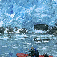 CORDILLERA SARMIENTO, Patagonia, Chile. Jack Miller & Philip Lloyd (MR) raft in Fjord of the Mountains, below calving glacier face in previously unexplored range.