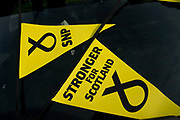 General election 2015. West Kilbride, Scotland. Eve of election calvacade around the town by the SNP (Scottish National Party). Bunting saying 'Stronger for Scotland'