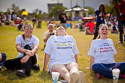 12 JUNE 2010 - PHOENIX, AZ: Nick McCannon, 15, his mom, Chez McCannon and his sister, Kaylene McCannon, 17, from San Diego, CA, cheer for Congressman Steve King (R-IA) during his speech at the rally in support of SB 1070 at Bolin Memorial Park near the State Capitol in Phoenix Saturday. About 500 people, many from California and Florida, came to Bolin Memorial Park in Phoenix Saturday. The pro SB 1070 rally was sponsored by Tea Party.   PHOTO BY JACK KURTZ