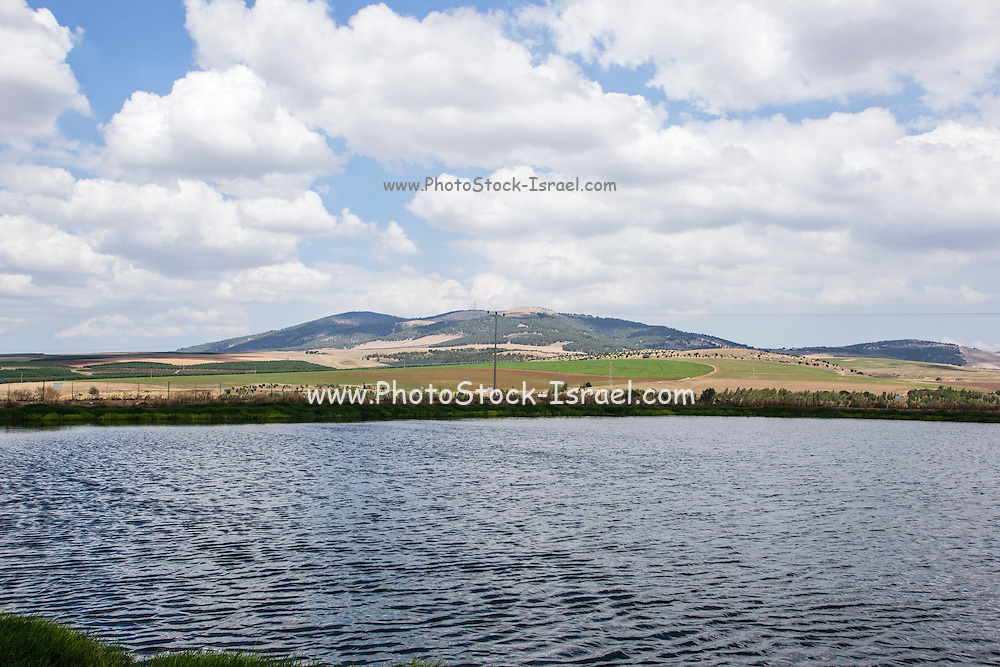 A rain water reservoir collects the surface flow during the rainy season. The water is then used in the dry season for irrigation. Photographed in  Israel, Lower Galilee, Ramat Hatzviam (Antelope Plain) Part of Issachar plains