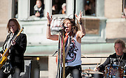 05 November 2012:  Aerosmith's Tom Hamilton, Steven Tyler and Joey Kramer perform a free concert in Boston's Allston neighborhood in front of the apartment building, 1325 Commonwealth Ave, which was the band's home in the early 1970's.  Boston, MA. ***Editorial Use Only*****
