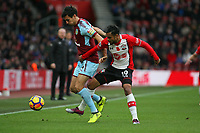 Football - 2017 / 2018 Premier League - Southampton vs. Burnley<br /> <br /> Jack Cork of Burnley and Southampton's Sofiane Boufal in action at St Mary's Stadium Southampton<br /> <br /> COLORSPORT/SHAUN BOGGUST