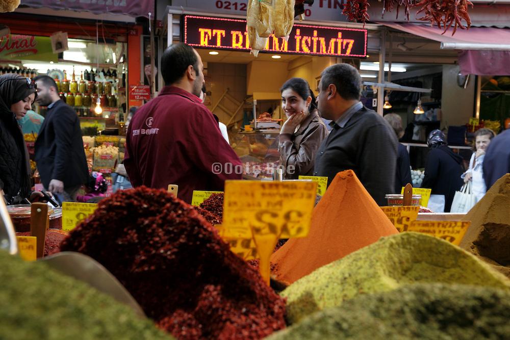 Turkeys woman talking to spice vendors in Istanbul