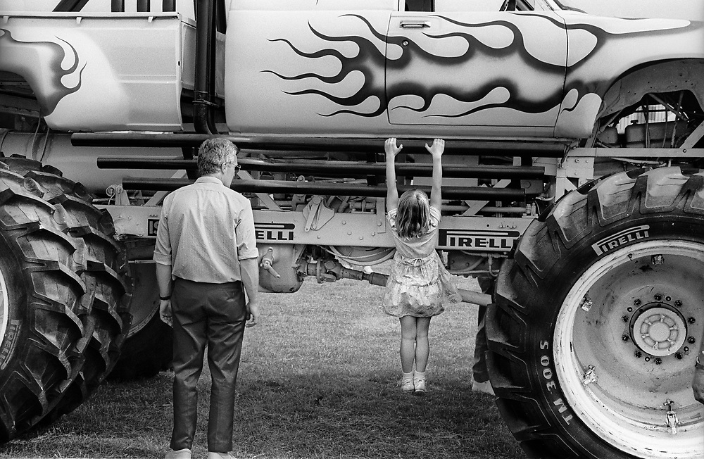 DAY TRIPPER - TRUCK SHOW  is a documentary photography series by photographer Paul Williams taken at the annual Truck Show Pickering North Yorkshire England in summer 1986. .<br /> <br /> Visit our REPORTAGE & STREET PEOPLE PHOTO ART PRINT COLLECTIONS for more wall art photos to browse https://funkystock.photoshelter.com/gallery-collection/People-Photo-art-Prints-by-Photographer-Paul-Williams/C0000g1LA1LacMD8
