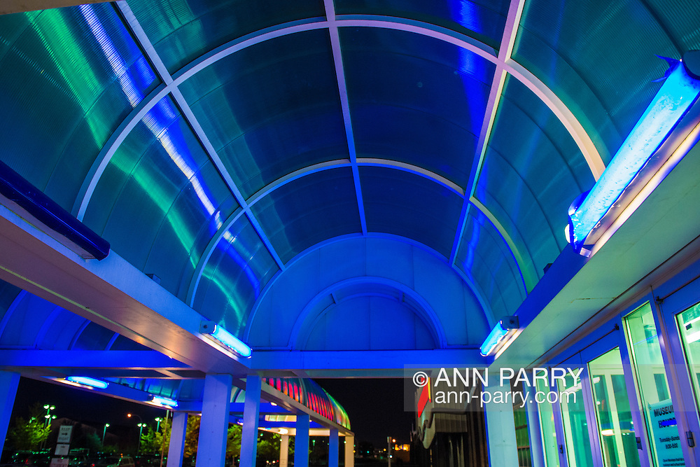 Colorfully lighted entrance to Cradle of Aviation, night of October 23, 2015. In CAM, before and after Astronaut Buzz Aldrin signing books after conversation.