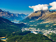 "St. Moritz and three lakes nestle in Upper Engadine Valley. See Lake St. Moritz (Lej da San Murezzanor or St. Moritzer See), Lake Sils (Lej da Segl, famous for windsurfing), Lake Silvaplana (Lej da Silvaplauna), and Maloja mountain pass. Visit Graubünden canton, Grison Alps, Switzerland, Europe. Reach Muottas Muragl viewpoint by funicular railway from a train station between Samedan-St. Moritz and Pontresina on the Bernina Express line. The Swiss valley of Engadine translates as the ""garden of the En (or Inn) River"" (Engadin in German, Engiadina in Romansh, Engadina in Italian). Published in Ryder-Walker Alpine Adventures ""Inn to Inn Alpine Hiking Adventures"" Catalog 2006."