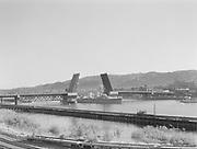 """9969-0920. German ship """"Karlsruhe"""" passing through Burnside bridge draw. June 27, 1932."""