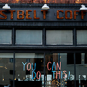 Rustbelt Coffee shares a motivational message on its windows in Toledo on Thursday, April 9, 2020. THE BLADE/KURT STEISS