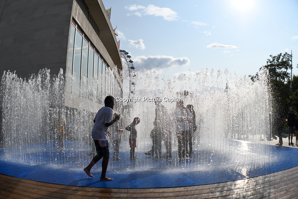 Heatwave People having fun at the Jeppe Heins Appearing Rooms Fountain Southbank Centre London, UK August 25 2018.