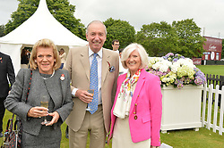 Left to right, ROS PACKER, JOHN CHALK and LIBBY REEVES PURDIE at the Cartier Queen's Cup Polo final at Guard's Polo Club, Smiths Lawn, Windsor Great Park, Egham, Surrey on 14th June 2015