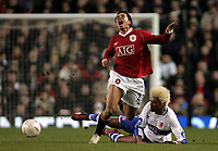 Photo: Paul Thomas.<br /> Manchester United v Middlesbrough. The FA Cup, Quarter Final replay. 19/03/2007.<br /> <br /> Kieran Richardson (L) of Utd is fouled by Abel Xavier.