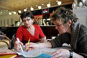 Gent, Belgie, Mar 16, 2009, Situaties binnenin Cultuurcafé De Vooruit, Stadsgidsen Mireille Matthys en Anna Katarina De Craene bereiden hun stadswandelingen voor, ©Christophe VANDER EECKEN