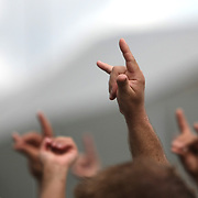 Fans give signs as the band Thousand Foot Krutch sings onstage at the Rockstar Energy Drink Festival at the 1-800-Ask-Gary amphitheater in Tampa, Florida on Thursday, September 13, 2012. (AP Photo/Alex Menendez)