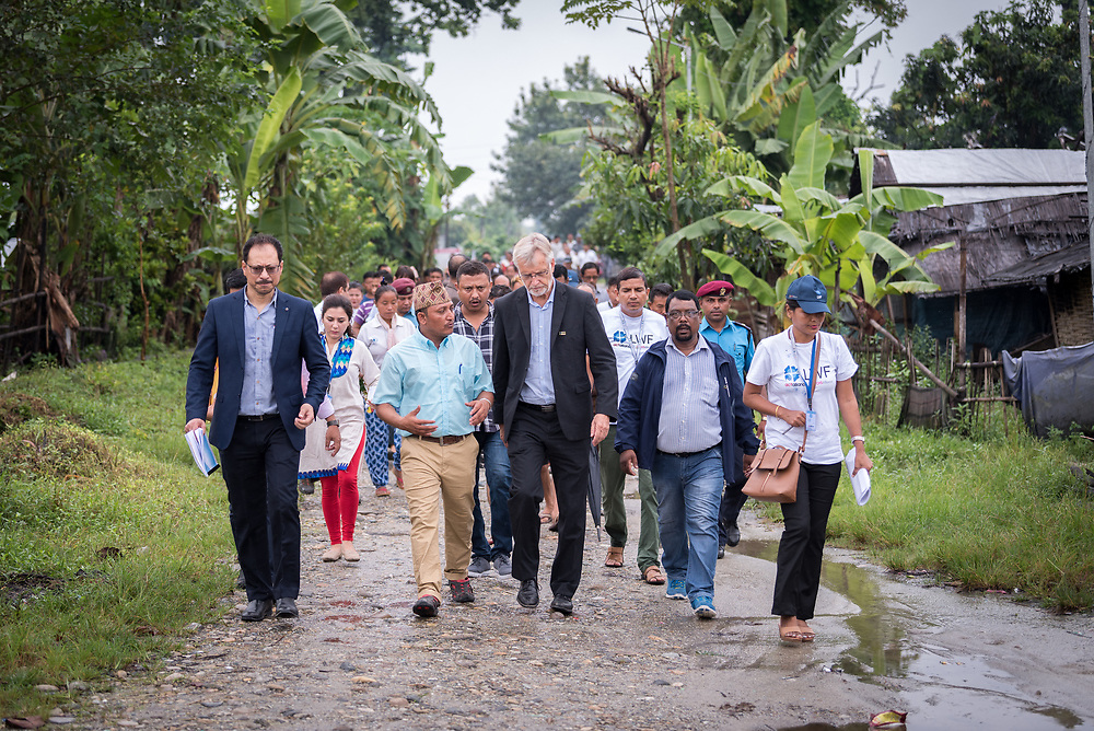 14 September 2018, Damak, Nepal: Rev. Dr Martin Junge (centre) visits the Beldangi refugee camp in the Jhapa district of Nepal, which hosts more than 5,000 Bhutanese refugees. Here, in conversation with camp secretary Tikaram Rasaily (left), himself a refugee. For the past two years, the refugees themselves oversee monitoring, maintenance and governance of the camp. On 12-19 September 2018, the Lutheran World Federation General Secretary Rev. Dr Martin Junge visits Nepal. He will participate in the 75th anniversary celebrations of the Nepal Evangelical Lutheran Church, an LWF member church, and visit development projects run by the church. He will also visit the LWF country program, which is involved in humanitarian relief and development work in a range of areas, supporting refugees, offering relief work to those most affected by the 2015 earthquake, flood victims, among other projects.
