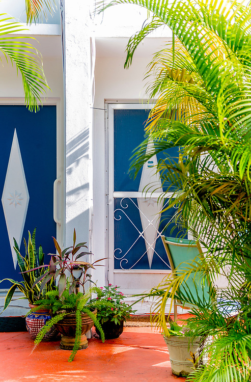 Doors with a starburst motif on a Miami Modern {MiMo) garden apartment in Bay Harbor Islands