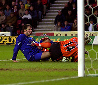 Photo. Richard Lane. <br />Southampton v Manchester United. Barclaycard Premiership. 01/02/2003<br />Ruud Van Nistelrooy puts a knee into Antti Niemi who was stretchered off as a result.