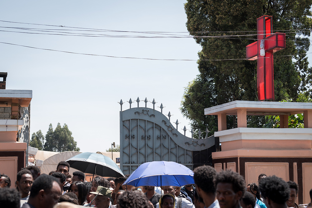 27 October 2019, Addis Ababa, Ethiopia: Congregants exit from Sunday service at the Finfinne Oromo Mekane Yesus Congregation of the Ethiopian Evangelical Church Mekane Yesus. In a context where congregations did not use to be allowed to hold their services in any language but Amharic, the congregation today is one of some 60 Oromo speaking Mekane Yesus congregations in Addis Ababa. The service takes place on the first Sunday following political turmoil in the country, claiming dozens of lives.