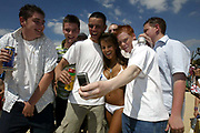 Hannah Joy is surrounded by fans after winning the bikini contest. St Georges Park Wandsworth, South West London, as part of the Sanex Urban Beach Party.