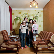 Tomasz 46, Kamilla 45, Kinga 11, Katarzyna 7 <br /> <br /> Jastrzebie Zdrój, average income, medium education<br /> <br /> Tomasz is the head electrician of a plastics factory. He thinks that he earns enough so his wife can take care of the kids that is a full time job. Lukasz the younger son who works as a baker contributes a bit to the house budget.<br /> <br /> On Sundays Lukasz goes to work very early so again we don't have the opportunity to eat all together. The Sunday lunch is earlier, usually around 2 o'clock. After the lunch we stay together and talk but the kids run to the computer to play games.
