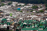 The corrugated metal roof tops of Karail slum area where approximately 200,000 people live on the 24th of September 2018 in Dhaka, Bangladesh The area on the banks Banani Lake is publicly owned land and has been put up for development.