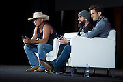 """LAS VEGAS, NV - JULY 10:  Donald """"Cowboy"""" Cerrone, CM Punk and John Gooden speak during UFC Fan Expo Day 3 at the Las Vegas Convention Center on July 10, 2016 in Las Vegas, Nevada. (Photo by Cooper Neill/Zuffa LLC/Zuffa LLC via Getty Images) *** Local Caption *** Donald """"Cowboy"""" Cerrone; CM Punk; John Gooden"""