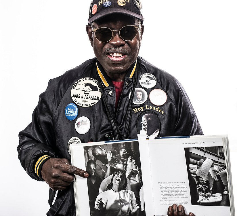General Larry Platt, Civil Rights Activist, photographed at the National Human and Civil Rights Museum in Atlanta, GA. He is shown holding an image of himself in Savannah, GA shot by Kenneth Thompson