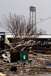 26 Sept, 2005. Cameron, Louisiana. Hurricane Rita aftermath. <br />  The destroyed remains of  downtown business in Cameron, Louisiana two days after the storm ravaged the small town. The water tower was one of the few remaining structures to survive the storm.<br /> Photo; ©Charlie Varley/varleypix.com
