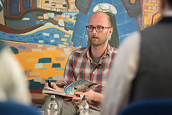 """A day of books in Portobello as part of the three-day long Portobello Book Festival. A series of packed events to hear a number of authors, some local, others from further afield talk about their writing. Pictured: Portobello-based comic artist Edward Ross discussing his debut graphic novel - """"Filmish: A Graphic Journey through Film""""<br /> <br /> <br /> © Jon Davey/ EEm"""