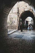 Jerusalem - October 20, 2010: A Palestinian woman walks in the Muslim Quarter of the Old City of Jerusalem