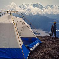 Trekkers overlook the Kali Gandaki Gorge, the deepest canyon on earth, separating the Dhaulagiri and Annapurna massifs.  Annapurna in background.