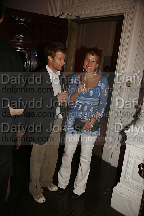 Tom Aikens and Amber Nuttall, Established and Sons celebrate the launch of a Red Production 'Aqua Table' by Zaha Hadid. ( Profits from Sales will go to Red Campaign HIV treatment in Africa) Grosvenor Place. London. 23 September 2006.  ONE TIME USE ONLY - DO NOT ARCHIVE  © Copyright Photograph by Dafydd Jones 66 Stockwell Park Rd. London SW9 0DA Tel 020 7733 0108 www.dafjones.com